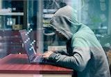 A hacker at his laptop.