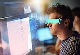 A hacker at his desktop.